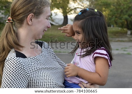 happy international family-Caucasian mother and a Latin child #784100665