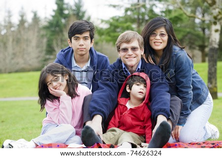 Happy interracial family enjoying a day at the park