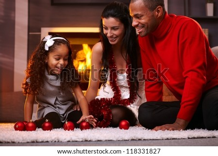 Family having fun at home at christmas time being together