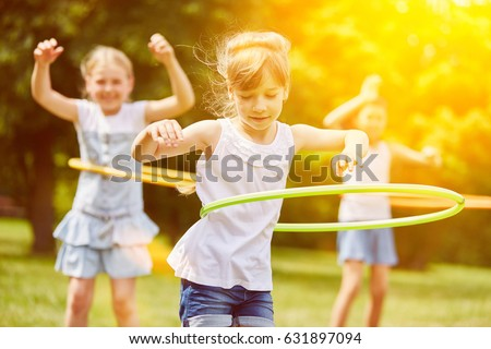 Happy interracial group of kids playing in summer #631897094
