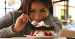 Happy Japanese woman indulges in fancy dessert