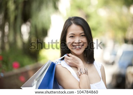 happy japanese woman with shopping bags
