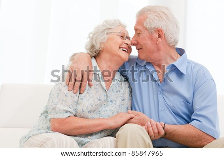 Happy joyful aged couple loving and enjoy the retirement at home