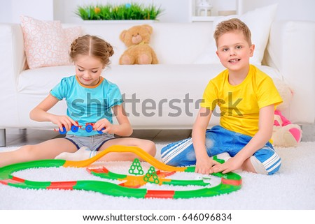 Happy joyful children playing together at home. Family concept.