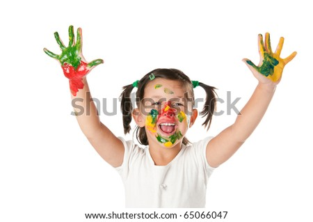 Happy joyful little girl playing with colors in her hands and face isolated on white background