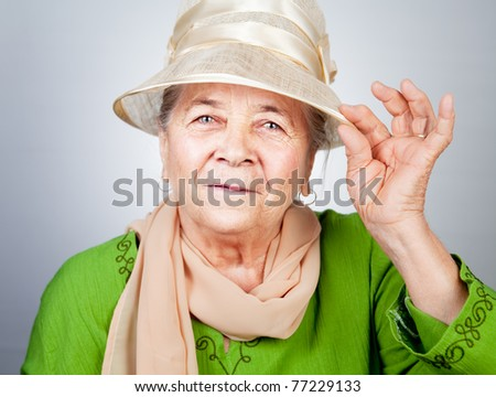 Happy joyful old senior lady in elegant nice clothes