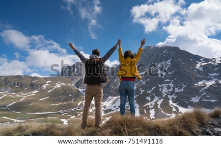 Happy joyful young couple walking on the foothills together. #751491118
