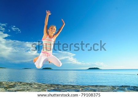Happy jump girl and sea in the background of blue sky - stock photo