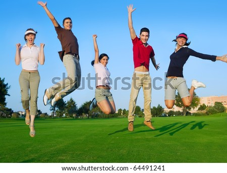 happy jump group of young people jumping outdoors grass [Photo Illustration]