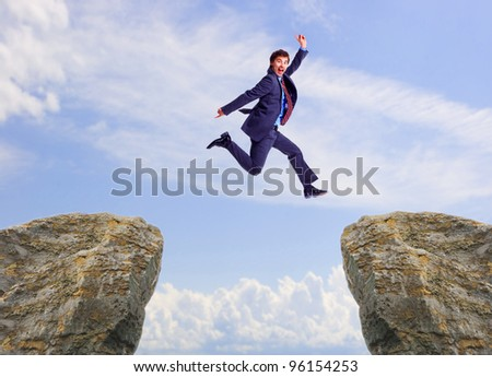 Happy jumping businessman. Success in business.