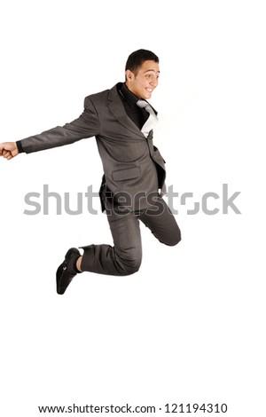 Happy jumping businessman who celebrates success