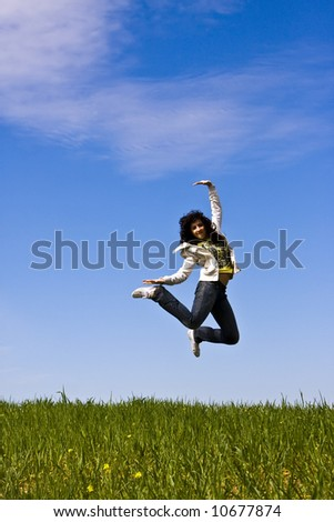 Happy jumping woman, vertical composition.