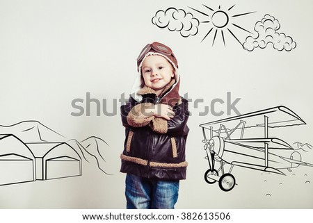 Happy kid against drawn airdrome and skies. Profession collection.