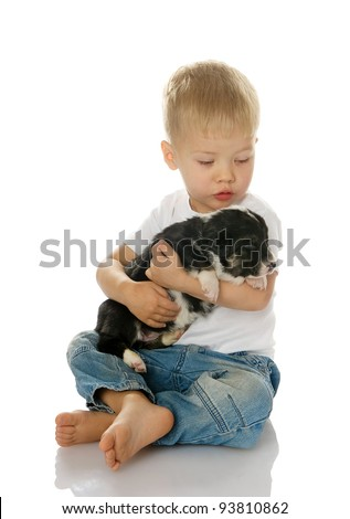 Happy kid boy bonding his puppy dog isolated on white background