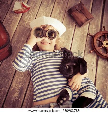 happy kid dressed in sailor....
