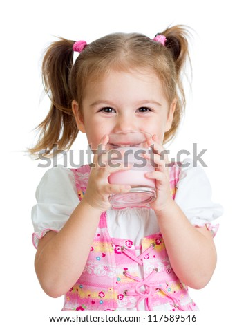 happy kid girl drinking yoghurt from glass isolated