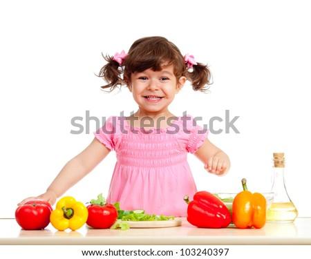 happy kid girl preparing healthy food