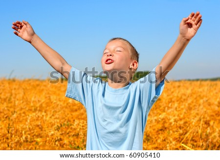 happy kid in wheat field