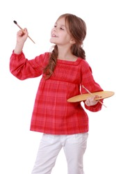 Happy kid on Art theme/Cute little girl painting a picture, isolated on white