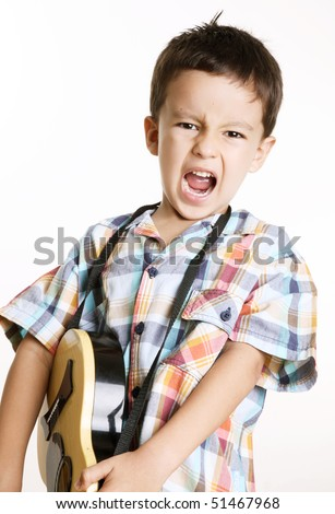 Happy kid playing guitar over white background