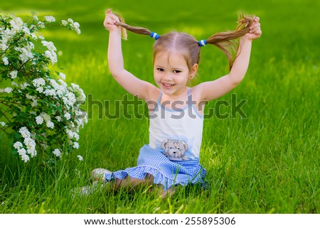 happy kid playing in a spring park
