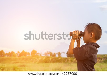Happy kid playing outdoors. Travel and adventure concept #477570001