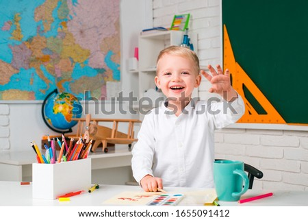 Happy Kid - Science education concept. First school day. Chalkboard copy space. Individual teaching. Individual teaching