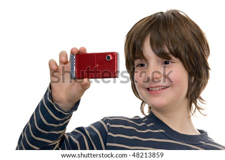 happy kid taking a photo with a cellular phone