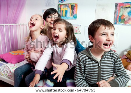 Happy kids and their mother