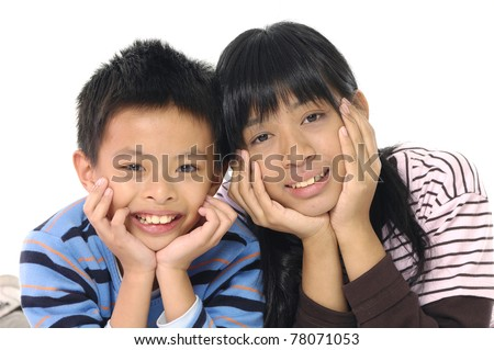 happy kids boy and girl lie on floor