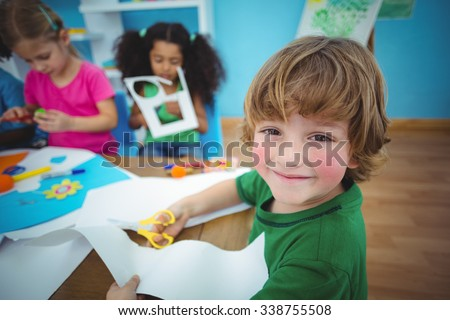 Happy kids doing arts and crafts together at their desk #338755508