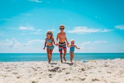 happy kids enjoy beach vacation, boy and girls have fun