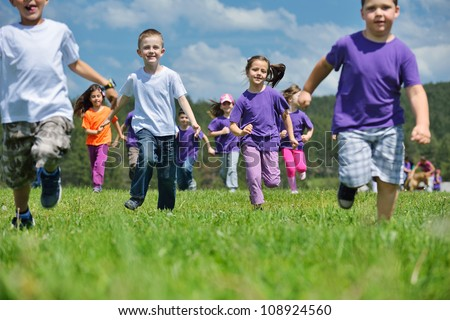 happy kids group have fun in nature outdoors park