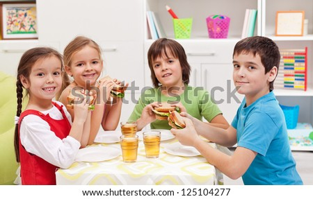 Happy kids having a healthy snack in their room