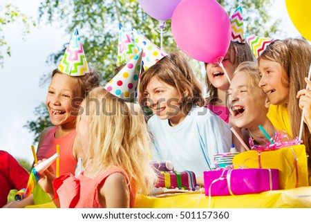 Happy kids having fun at outdoor B-day party #501157360