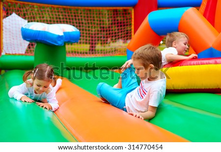 happy kids having fun on inflatable attraction playground #314770454