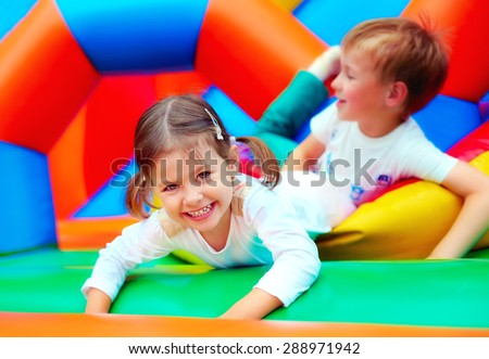 happy kids having fun on playground in kindergarten #288971942