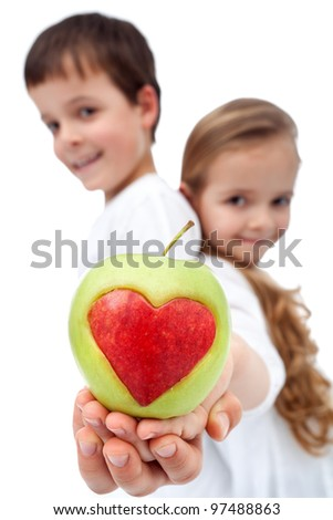 Happy kids holding apple - healthy eating concept