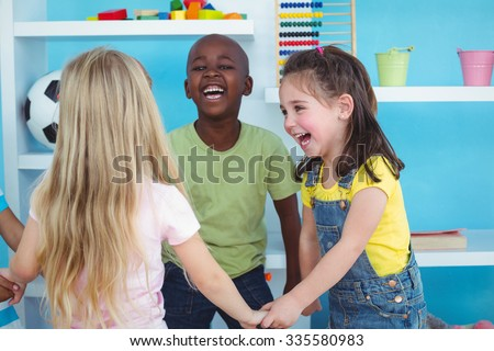 Happy kids holding hands together in the bedroom #335580983