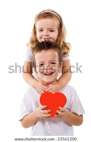 Happy kids hugging and holding a red heart - isolated - stock photo