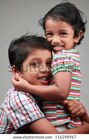 Happy kids hugging each other - stock photo