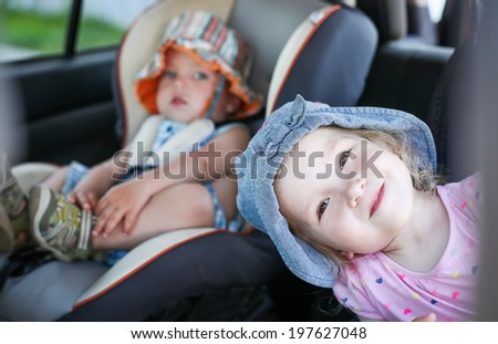 happy kids in the car in summer