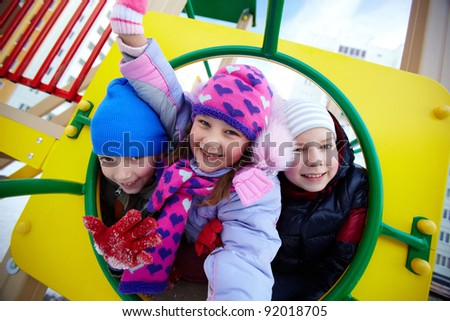 Happy kids looking at camera while having fun on playground