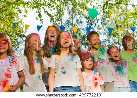 Happy kids painted in the colors of Holi festival #495772210