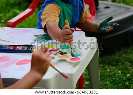 Happy kids painting .Activity outdoor in summer.  #664060231