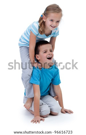 Happy kids playing and wrestling together - isolated