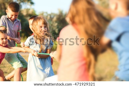 Happy kids playing in park #471929321