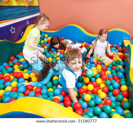 Happy kids playing in the colorful balls