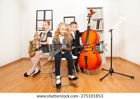 Happy kids playing musical instruments together