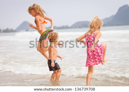 happy kids playing on beach